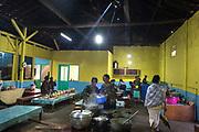 Tenggerese women cook for a wedding reception in Ngadas Village near Bromo mountain, Probolinggo, East Java, 2017. The two-day wedding reception was held by a success local farmer.