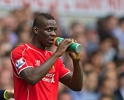 LONDON, ENGLAND - Sunday, August 31, 2014: Liverpool's Mario Balotelli takes a drink during the Premier League match against Tottenham Hotspur at White Hart Lane. (Pic by David Rawcliffe/Propaganda)