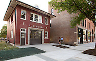 People walk by the restored firehouse at the CSPS Hall Grand Re-opening in Cedar Rapids on Friday evening, August 26, 2011. About 190 people attended the event which featured a concert by Susan Werner.
