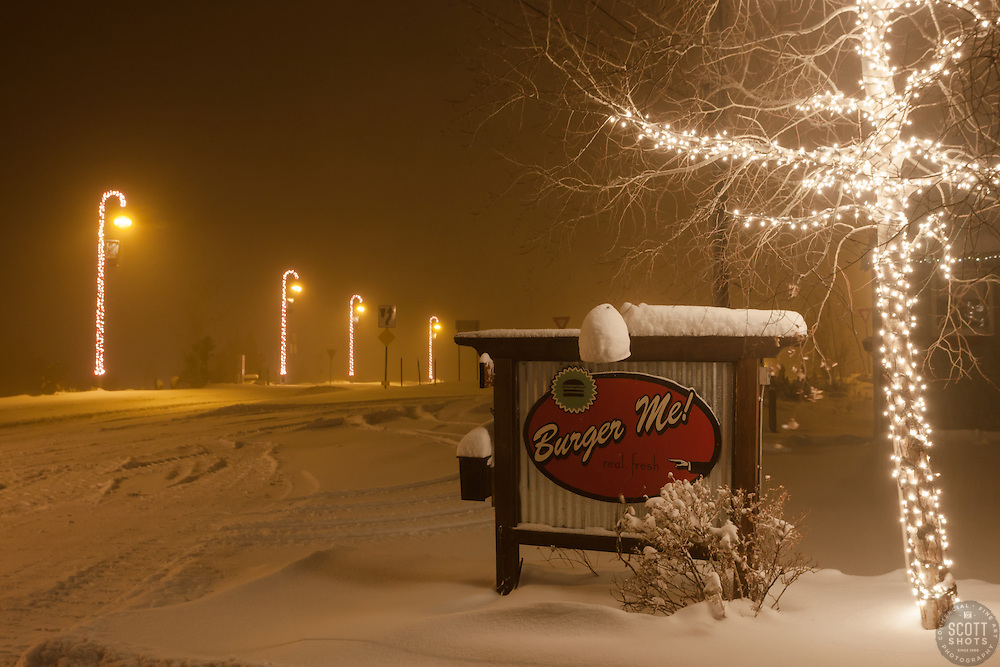 """Downtown Truckee 12"" - Photograph of a snow covered burger sign and Christmas lights in Downtown Truckee, California. Photographed in the early morning."