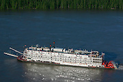 The Mississippi Queen paddlewheeler uphill on the Mississippi River South of Memphis, seen from helicopter.