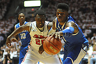 """Kentucky's Nerlens Noel (3) grabs the ball away from Mississippi's Nick Williams (20) at the C.M. """"Tad"""" Smith Coliseum on Tuesday, January 29, 2013.  (AP Photo/Oxford Eagle, Bruce Newman).."""
