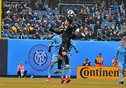 DC United midfielder Junior Moreno (5) heads the ball against the New Your City Football Club during the second half of an MLS soccer game at Yankee Stadium in New York, NY, Sunday, March 10, 2019. (Bennett Cohen/image of Sport)