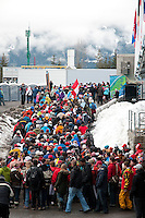 Spectators leave the Whistler Sliding Centre course after the 4-man bobsleigh finals during the 2010 Olympic Winter Games in Whistler, BC Canada.