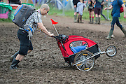 Buggies struggle with the mud - The 2016 Glastonbury Festival, Worthy Farm, Glastonbury.