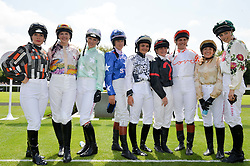 Left to right, MAGGIE BUGGIE, ALEXIS GREEN, LEONORA SMEE, PHILIPPA HOLLAND, MEGAN NICHOLLS, LAURA REDVERS, TINA COOK, CLARE SALMON and EDIE CAMPBELL at the 2014 Glorious Goodwood Racing Festival at Goodwood racecourse, West Sussex on 31st July 2014.