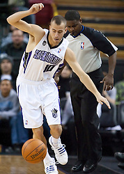 November 27, 2009; Sacramento, CA, USA;  Sacramento Kings guard Sergio Rodriguez (10) saves a loose ball during the third quarter against the New Jersey Nets at the ARCO Arena. Sacramento defeated New Jersey 109-96.