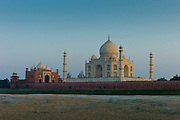 The Taj Mahal North Side viewed across Yamuna River at sunset , India