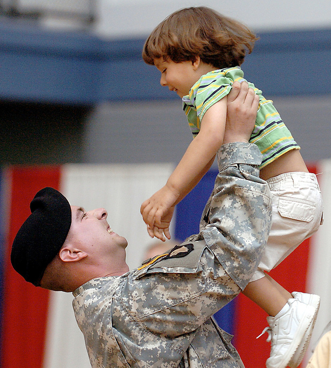 Sgt. Brian Hague of Danielson, left, plays with his nephew Micah Tarlton after a send off ceremony of 192 nd Engineer Battalion in support of Operation Iraqi Freedom at the Hartford Armory in Hartford, Conn.