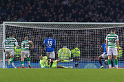 Celtic Keeper stops the penalty from James Tavernier (C) of Rangers FC during the Betfred Scottish League Cup Final match between Rangers and Celtic at Hampden Park, Glasgow, United Kingdom on 8 December 2019.