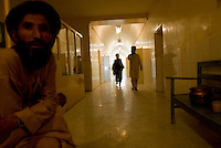 Helmand Province, Lashkargah City. A patient sits in the corridor of Lashkargah Governmental Hospital