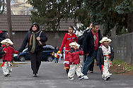 Middletown, New York - Members of St. Joseph's Church walk to the church before the festival of Nuestra Senora de Guadalupe on Sunday, Dec. 9, 2012.