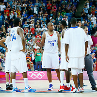 08 August 2012: Team France looks dejected around Boris Diaw following the 66-59 Team Spain victory over Team France, during the men's basketball quarter-finals, at the 02 Arena, in London, Great Britain.