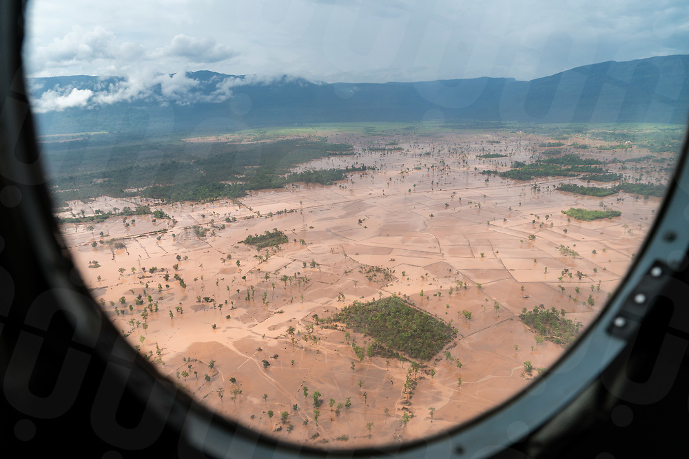 August 06, 2018 - Attapeu (Laos). An army helicopter flies over one of the affected areas by the fury of the floods to bring food supplies to the remote village of Bane Pindong. Most of the villages are still cut off by the flood waters and only reachable by air or after a dangerous drive by 4x4 vehicles and tractors © Thomas Cristofoletti / Ruom