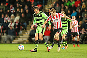 Forest Green Rovers Darren Carter & Cheltenham Town's George McLennan during the Vanarama National League match between Cheltenham Town and Forest Green Rovers at Whaddon Road, Cheltenham, England on 21 November 2015. Photo by Shane Healey.