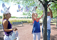 From left, Nicole Augustine, Tara Bane and Judi Reiss hang 4,000 paper doves -- 2,977 to represent each of the people who died on 9/11, Wednesday September 7, 2016 at the Garden of Reflection in Lower Makefield, Pennsylvania. (Photo by William Thomas Cain)