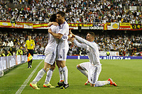 Real Madrid´s Gareth Bale celebrates a goal with Xabi Alonso and Sergio Ramos during the Spanish Copa del Rey `King´s Cup´ final soccer match between Real Madrid and F.C. Barcelona at Mestalla stadium, in Valencia, Spain. April 16, 2014. (ALTERPHOTOS/Victor Blanco)