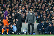 Manchester City manager Pep Guardiola disputes a decision and gestures during the Champions League Quarter-Final 1st leg between Tottenham Hotspur and Manchester City at Tottenham Hotspur Stadium, London, United Kingdom on 9 April 2019.