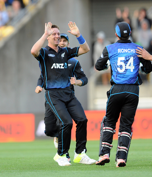 New Zealand's Matt Henry, left, high fives with Luke Ronchi after he took the catch off his bowling to dismiss Australia's Steve Smith for 2 in the 2nd One Day International Cricket match at Westpac Stadium, Wellington, New Zealand, Saturday, February 06, 2016. Credit:SNPA / Ross Setford