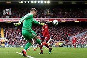 Burnley goalkeeper Thomas Heaton (1) clears the danger from Liverpool forward Sadio Mane (10) during the Premier League match between Liverpool and Burnley at Anfield, Liverpool, England on 10 March 2019.