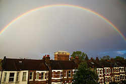 © Licensed to London News Pictures. 30/04/2020. London, UK. A double rainbow appears as members of public in in Haringey, north London take part in the 'Clap For Our Carers' by applauding NHS staff, carers and key workers. The campaign has been encouraging people across the UK to take part in a round of applause from their windows, doors and front gardens to show their appreciation for the efforts of the NHS staff, carers and key workers during the COVID-19 pandemic. Photo credit: Dinendra Haria/LNP
