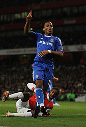 in action during the Barclays Premier League match between Arsenal and Chelsea at the Emirates Stadium on December 27, 2010 in London, England.