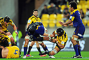 Highlanders lock Jarrad Hoeata throws off Victor Vito. Super 15 rugby match - Hurricanes v Highlanders at Westpac Stadium, Wellington, New Zealand on Friday, 18 February 2011. Photo: Dave Lintott/PHOTOSPORT