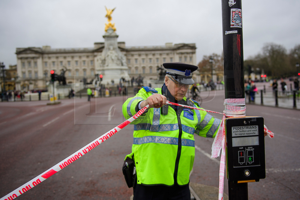 © Licensed to London News Pictures. 21/12/2016. London, UK. Road closures in place around Buckingham Palace in London at the time of Changing of the Guard ceremony. The extra closures have come in to place following a terrorist attack using a vehicle in Berlin.  Photo credit: Ben Cawthra/LNP