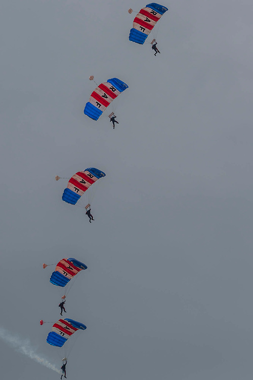 The RAF Falcons parachute display team - Duxford Battle of Britain Air Show taking place during IWM (Imperial War Museum) Duxford's centenary year. Duxford's principle role as a Second World War fighter station is celebrated at the Battle of Britain Air Show by more than 40 historic aircraft taking to the skies.
