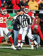 KANSAS CITY, MO - NOVEMBER 19:  NFL side judge Rick Patterson #15 rules no catch after a pass play during the Kansas City Chiefs game against the Oakland Raiders at Arrowhead Stadium on November 19, 2006 in Kansas City, Missouri. The Chiefs defeated the Raiders 17-13. ©Paul Anthony Spinelli *** Local Caption *** Rick Patterson
