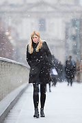 UNITED KINGDOM, London: 26 February 2018 <br /> Commuters brave the cold weather this morning as they walk over Millennium Bridge, London. The cold blast of weather has been labelled the 'Beast from the East' and is expected to cause havoc across eastern parts of the country. <br /> Rick Findler