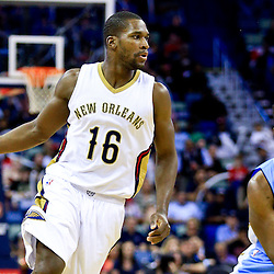 Mar 31, 2016; New Orleans, LA, USA; New Orleans Pelicans guard Toney Douglas (16) drives to the basket against the Denver Nuggets during the second half of a game at the Smoothie King Center. The Pelicans defeated the Nuggets 101-95. Mandatory Credit: Derick E. Hingle-USA TODAY Sports