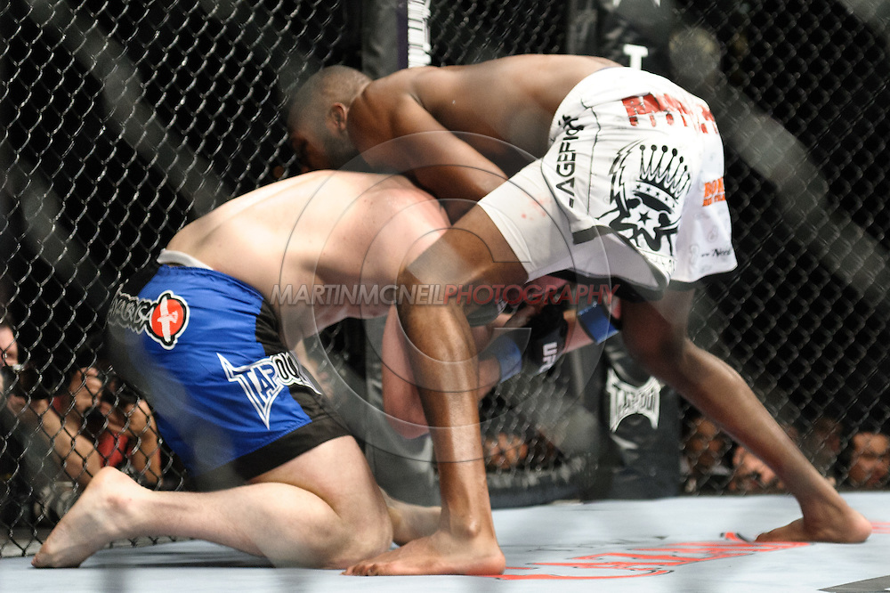 "LAS VEGAS, NEVADA. JULY 11, 2009: Jake O'Brien (left) is caught in a guillotine choke by Jon Jones during ""UFC 100: Making History"" inside the Mandalay Bay Events Center in Las Vegas, Nevada."