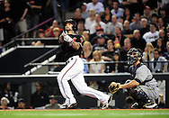 Oct. 5 2011; Phoenix, AZ, USA; Arizona Diamondbacks infielder Ryan Roberts (14) hits a grand slam during the first inning against the Milwaukee Brewers at game four of the 2011 NLDS at Chase Field. Mandatory Credit: Jennifer Stewart-US PRESSWIRE.