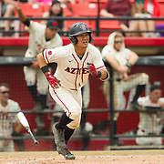 15 April 2018: San Diego State infielder Jacob Maekawa (3) hits an rbi double in the second inning to give the Aztecs a 3-0 lead over the Titans. The San Diego State baseball team closed out the weekend series against Cal State Fullerton with a 9-6 win at Tony Gwynn Stadium. <br /> More game action at sdsuaztecphotos.com