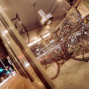 Looking in the windows at night at a bicycle store at 39th and Main, Kansas City MO.