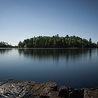 Camping Pipestone Bay in the Boundary Waters Canoe Area Wilderness (BWCAW) with a view of New York Island (right) in Minnesota. The BWCAW is part of Superior National Forest and is under the administration of the U.S. Forest Service. The wilderness area receives about 250,000 visitors each year and is one of the nation's most visited wilderness areas.