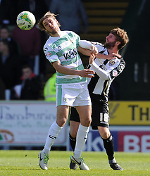 Yeovil Town's Sam Foley challenges for the high ball with Paddy McCourt of Notts County - Photo mandatory by-line: Harry Trump/JMP - Mobile: 07966 386802 - 11/04/15 - SPORT - FOOTBALL - Sky Bet League One - Yeovil Town v Notts County - Huish Park, Yeovil, England.