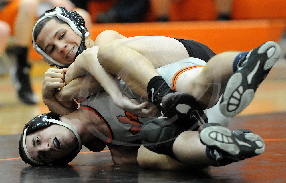 TOM KELLY IV &mdash; DAILY TIMES<br /> Marple Newtown's Dimitri Stergiou wrestles Strath Haven's Devon Moore during the 138 lb match during the Strath Haven at Marple Newtown wresting match, on Wednesday December 17, 2014.