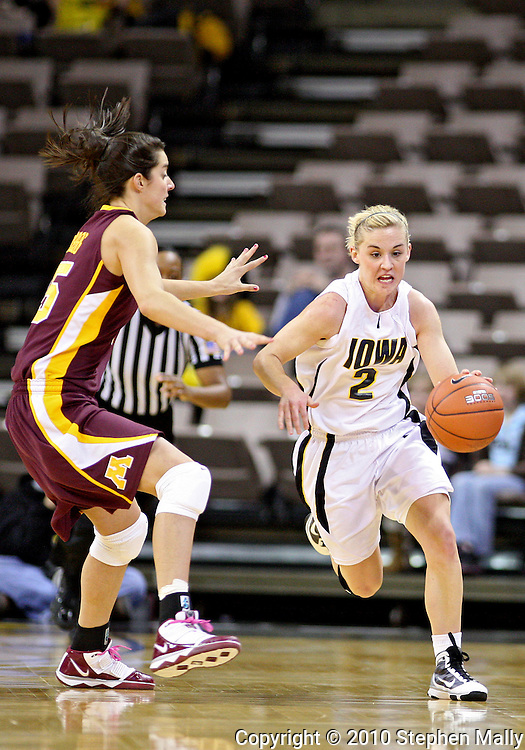February 18, 2010: Iowa guard Kamille Wahlin (2) drives around Minnesota forward Katie Loberg (25) during the second half of the NCAA women's basketball game at Carver-Hawkeye Arena in Iowa City, Iowa on February 18, 2010. Iowa defeated Minnesota 75-54.