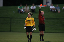 Vermont's GK Eliza Bradley (1) is given a red card for a second dangerous tackle outside of the box.  The Virginia Cavaliers Women's Soccer Team defeated the University of Vermont 6-0 on September 15, 2006 at Klöckner Stadium in Charlottesville, VA...