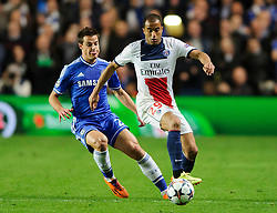 PSG Midfielder Lucas (BRA) is challenged by Chelsea Defender Cesar Azpilicueta (ESP) - Photo mandatory by-line: Rogan Thomson/JMP - 07966 386802 - 08/04/2014 - SPORT - FOOTBALL - Stamford Bridge, London - Chelsea v Paris Saint-Germain - UEFA Champions League Quarter-Final Second Leg.