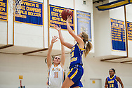 Lamoille's Katelin Collins (15) leaps over Milton's Katie Rayner (11) to take a shot during the girls basketball game between Lamoille and Milton at Milton High School on Friday night December 18, 2015 in Milton, (BRIAN JENKINS/for the FREE PRESS)