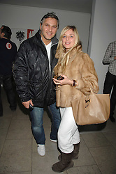 Former model SUZANNE MIZZI and FRANK CAMILLERI at The Week of Living Dangerously an exhibition and concert by Richard Ascott and Phil Colbert of fashion label Rodnik held at The Hospital, Endell Street, London on 25th March 2008.<br />