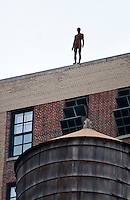 New York, New York City. Statue of a figure on top of a building.