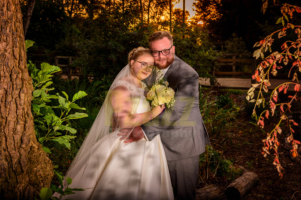 Bride and Groom at Sunset in the beautiful grounds at Shortmead House
