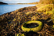 "Abandoned tyre washed up on shores of Slaney river, Wexford This mage can be licensed via Millennium Images. Contact me for more details, or email mail@milim.com For prints, contact me, or click ""add to cart"" to some standard print options."