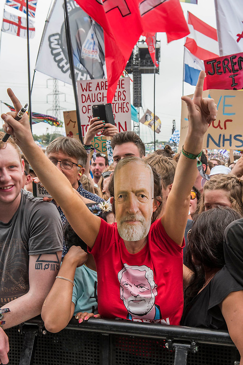Jeremy Corbyn is introduced to an enthusiastic crowd at the Pyramid Stage by Michael Eavis - The 2017 Glastonbury Festival, Worthy Farm. Glastonbury, 24 June 2017