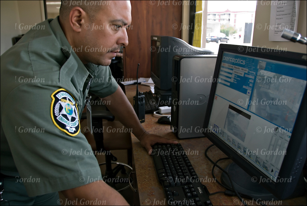 Correction Officer (2351) checking undercarriage of Vehicles on computer screen as they entering the GATE 1 North Perimeter Sallyport with the Vehicle Inspection System.