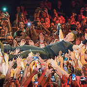 Bruce Springsteen crowd surfing  at the AccorHotels Arena in Paris,France,on Wednesday evening July 13th.